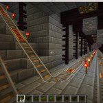 Mining tunnel with circuitous rail line and exposed precious ores.