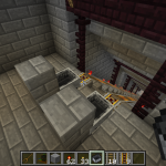 Mining tunnel access in basement, complete with stairs, rails, carts, and torches.  Ores are left exposed.